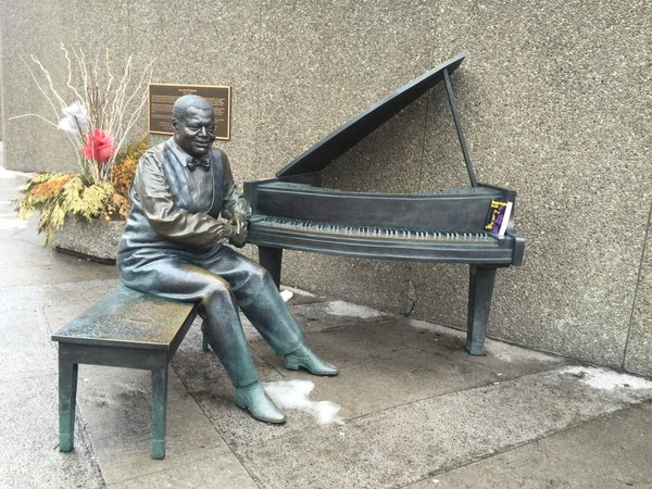 Oscar Peterson sculpture with Dexter Gordon's biography dropped